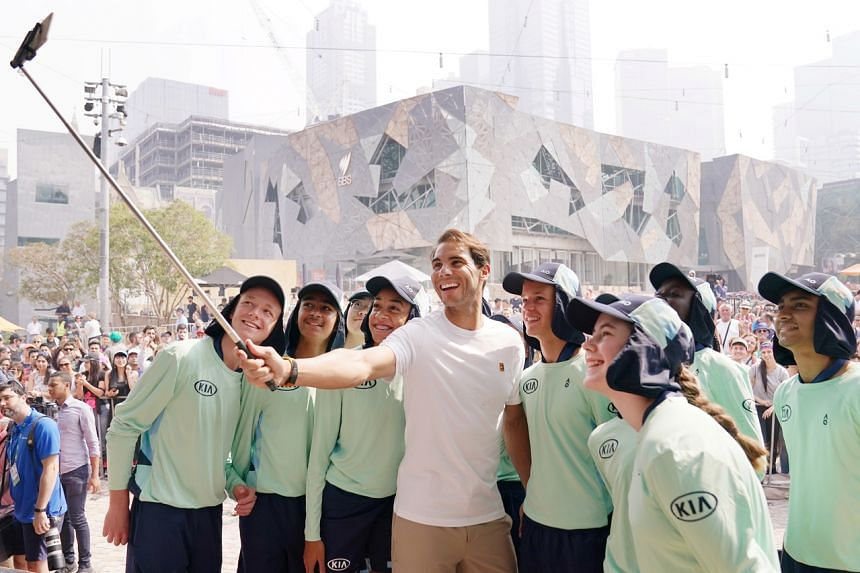 Rafael Nadal of Spain takes a selfie with ballkids in Melbourne on Jan 15, 2020. The Australian Open is the Grand Slam that the 19-times champion has found the hardest to win.