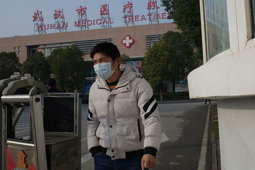 A man leaves the Wuhan Medical Treatment Centre in Hubei province, China, on Jan 12, 2020. One of the 41 patients reported in the city could have been infected by her husband, Wuhan's health commission said.