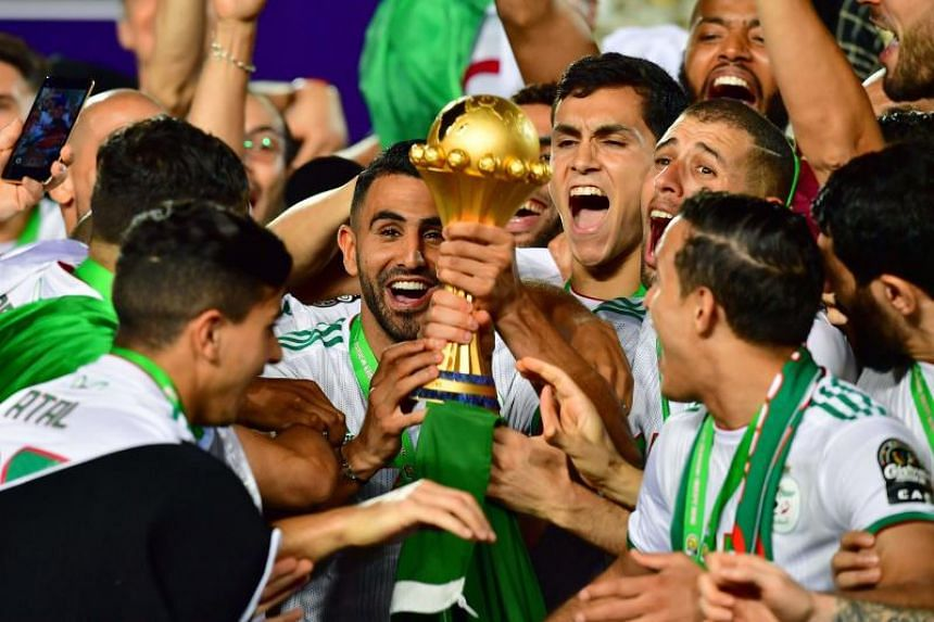 In a photo taken on July 19, 2019, the Algerian team celebrates after winning the 2019 Africa Cup of Nations (CAN) Final football match at the Cairo International Stadium.