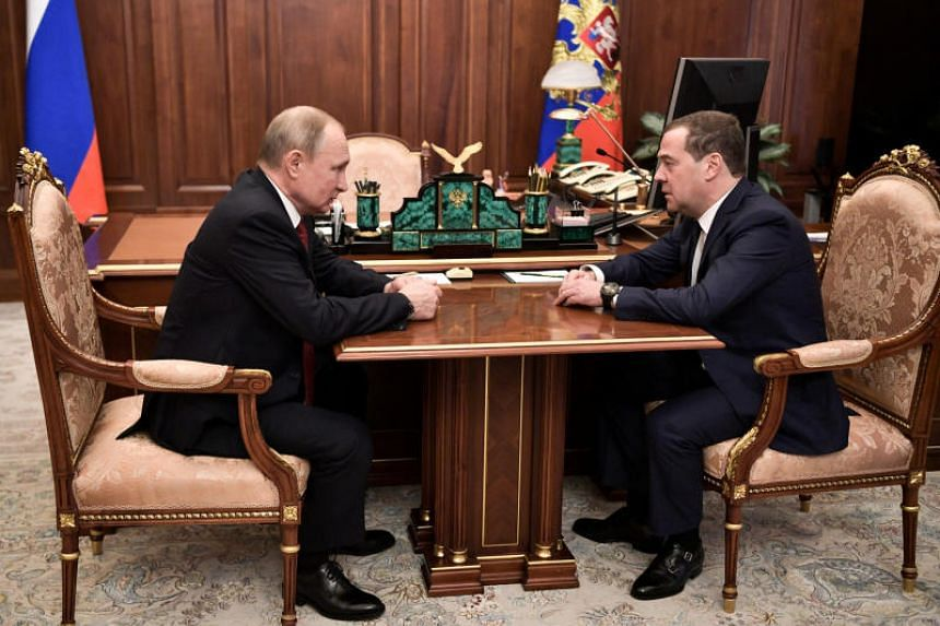 Russian President Vladimir Putin (left) meets with Prime Minister Dmitry Medvedev in Moscow on Jan 15, 2020.
