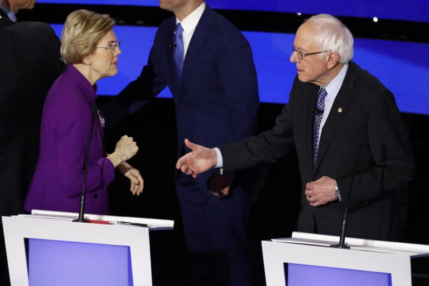 US Democratic presidential candidates Elizabeth Warren and Bernie Sanders during a debate in Des Moines on Jan 14, 2020.