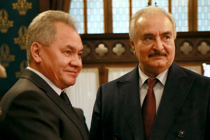 Libyan military commander Khalifa Haftar (right) meets with Russian Defense Minister Sergei Shoigu in Moscow on Jan 13, 2020.