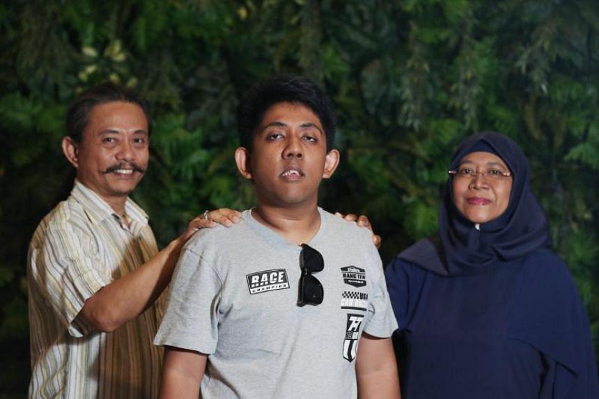 Muhammad Nur Arif Muzani (centre), with his parents, Mr Muzani Jaffar and Madam Jaliah Mohammad.