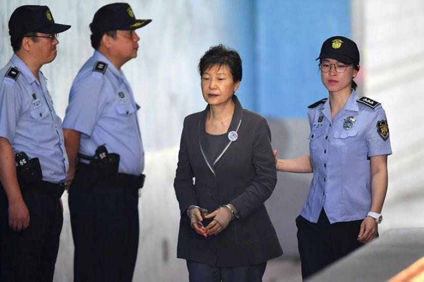 In a file photo taken on Aug 7, 2017, South Korea's ousted president Park Geun-hye arrives at the Seoul Central District Court for her trial.
