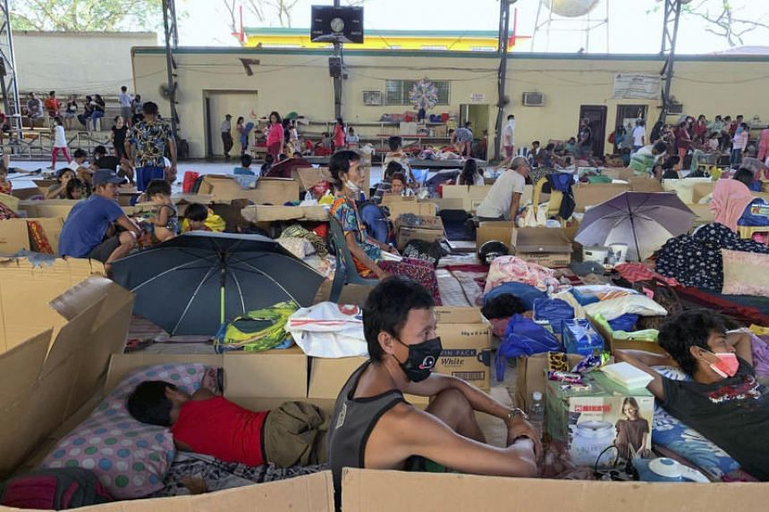 People rest at an evacuation centre in Batangas province, Philippines on Jan 14, 2020.