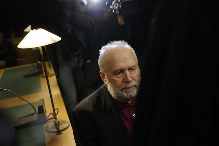 French former priest Bernard Preynat arrives at the court for his trial, in Lyon.