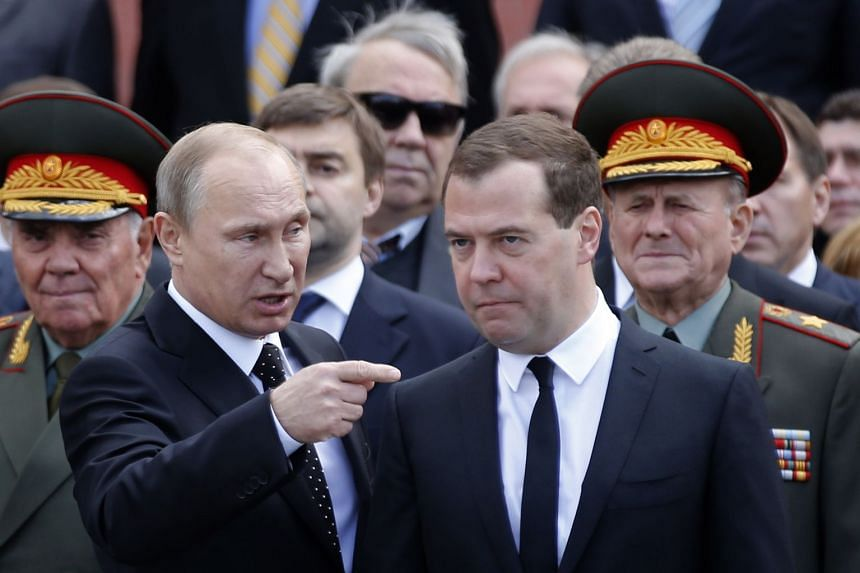 A 2014 photo shows Putin (left) and Medvedev at a wartime wreath laying ceremony in Moscow.