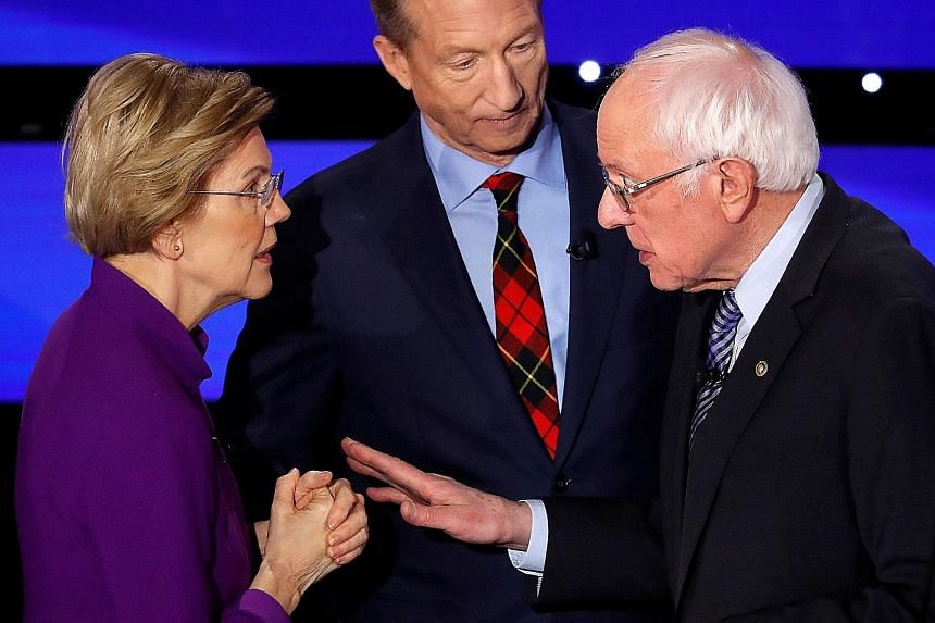 Ms Warren in a tense exchange with Mr Sanders moments after the debate, as Mr Steyer looked on. Ms Warren had walked towards Mr Sanders, who offered his hand, but she declined to take it, clasping her hands instead.