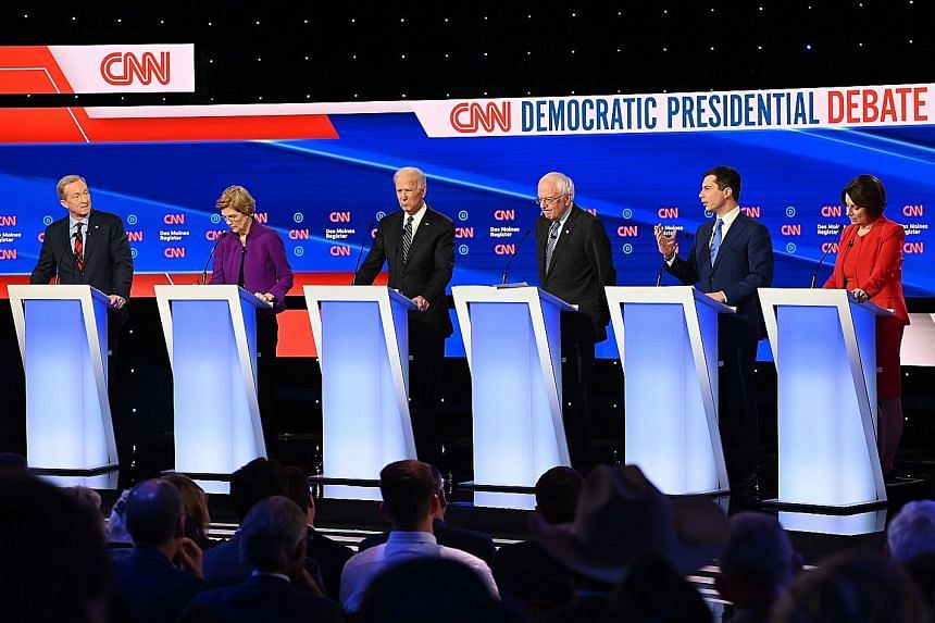 Democratic presidential hopefuls (from left) Tom Steyer, Elizabeth Warren, Joe Biden, Bernie Sanders, Pete Buttigieg and Amy Klobuchar participating in the seventh Democratic primary debate of the 2020 presidential campaign season at the Drake Univer