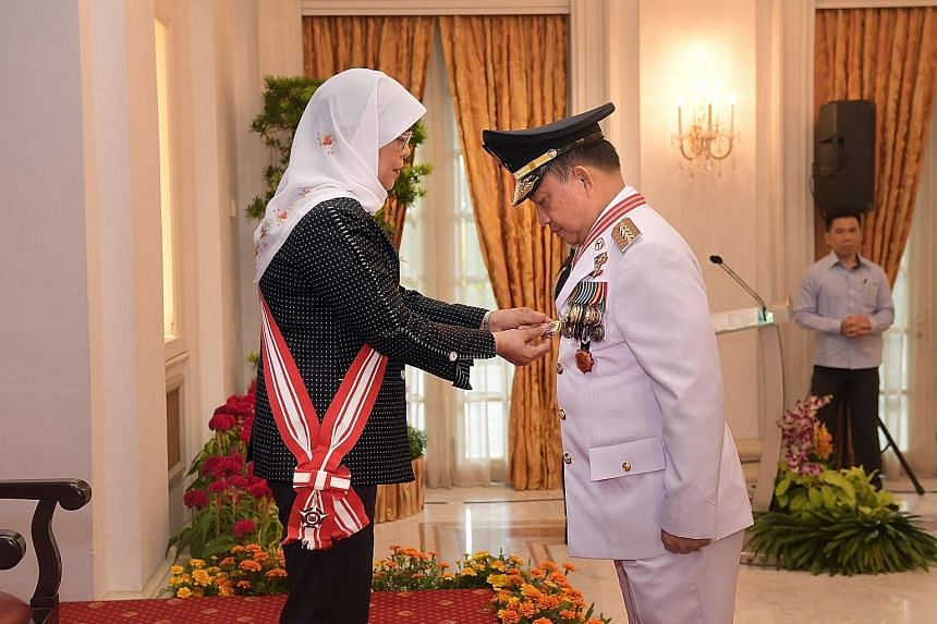 Indonesia's Minister of Home Affairs, Professor H. Muhammad Tito Karnavian, was conferred the Darjah Utama Bakti Cemerlang (Distinguished Service Order) by President Halimah Yacob at the Istana State Room yesterday. Prof Tito, who is also a retired p