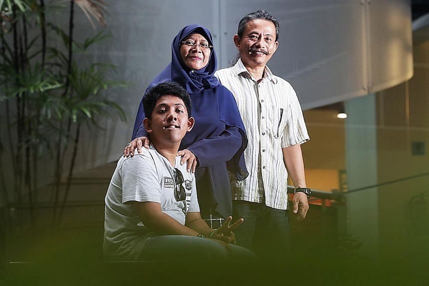 (From far left) Muhammad Nur Arif Muzani, seen here with parents Jaliah Mohammad and Muzani Jaffar, acted in Layang Layang Terbang Melayang (The Kite Soars High), a short film by Minds.
