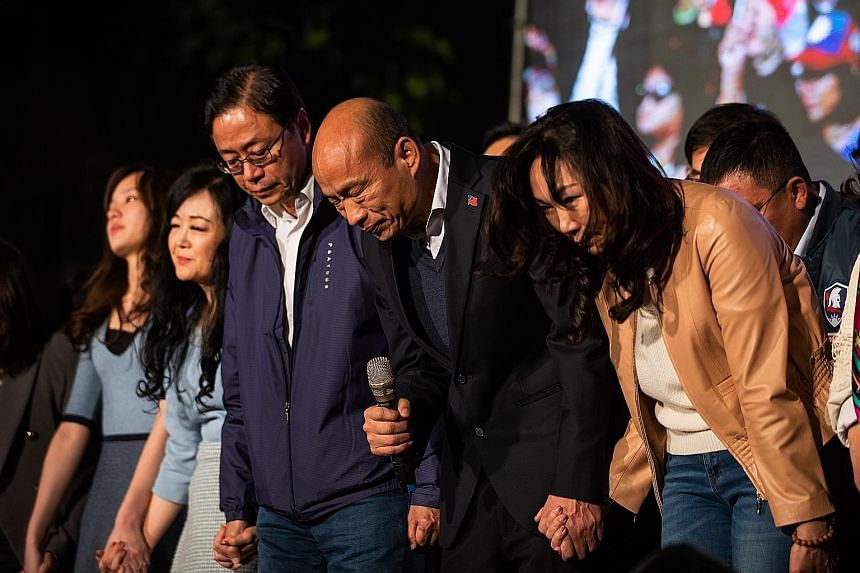 Kuomintang candidate Han Kuo-yu, surrounded by his family and party members, bowing to supporters at a rally in Kaohsiung, Taiwan, last Saturday. He received about 39 per cent of the votes. PHOTO: BLOOMBERG