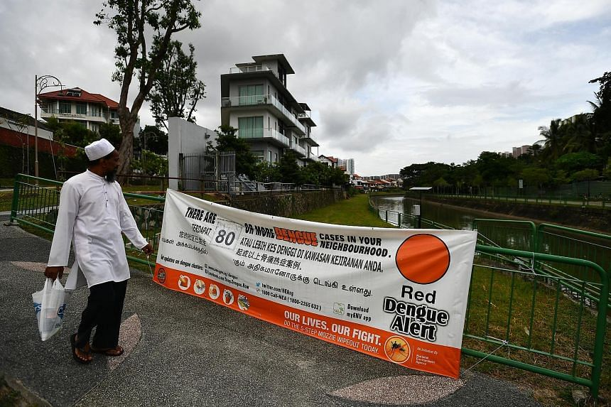 A dengue alert banner put up in Gerald Drive. Last week, 345 people were diagnosed with dengue - a 50 per cent rise over the number of infections seen in mid-December.