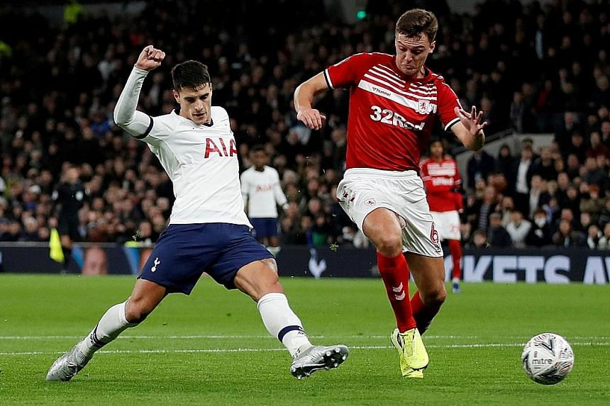 Erik Lamela (left) scoring Tottenham's second goal during the FA Cup third-round replay against Middlesbrough on Tuesday. Spur's 2-1 victory set up a clash against fellow Premier League side Southampton on Jan 25.