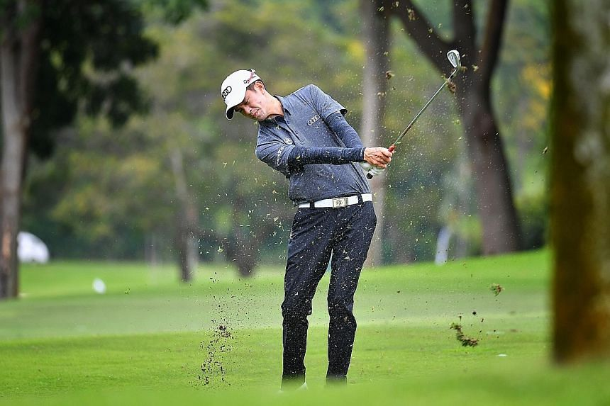 Top Singapore golfer Quincy Quek practising at the Sentosa Golf Club yesterday. The world No. 496 leads 13 local golfers at the Singapore Open this week, the most the Republic has had in the event in 15 years. ST PHOTO: CHONG JUN LIANG
