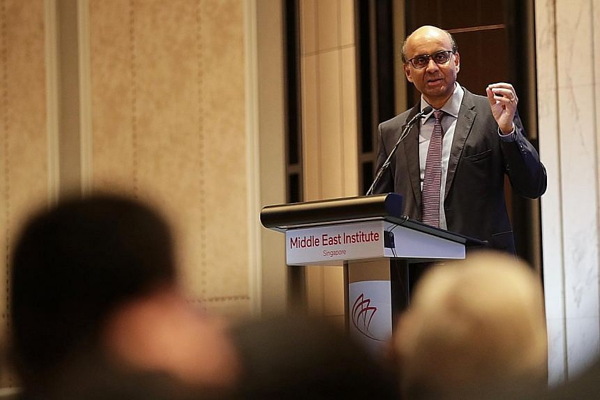 Mr Tharman Shanmugaratnam, Senior Minister and Coordinating Minister for Social Policies, delivering his speech during The Middle East Institute's annual conference at Orchard Hotel yesterday.