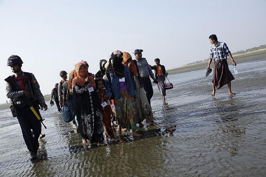 Muslim migrants arriving at Thae Chaung village in Sittwe, Rakhine state, western Myanmar, on Monday. The survey showed that the majority of respondents in each Asean member state did not approve of Asean's response to the Rakhine crisis.