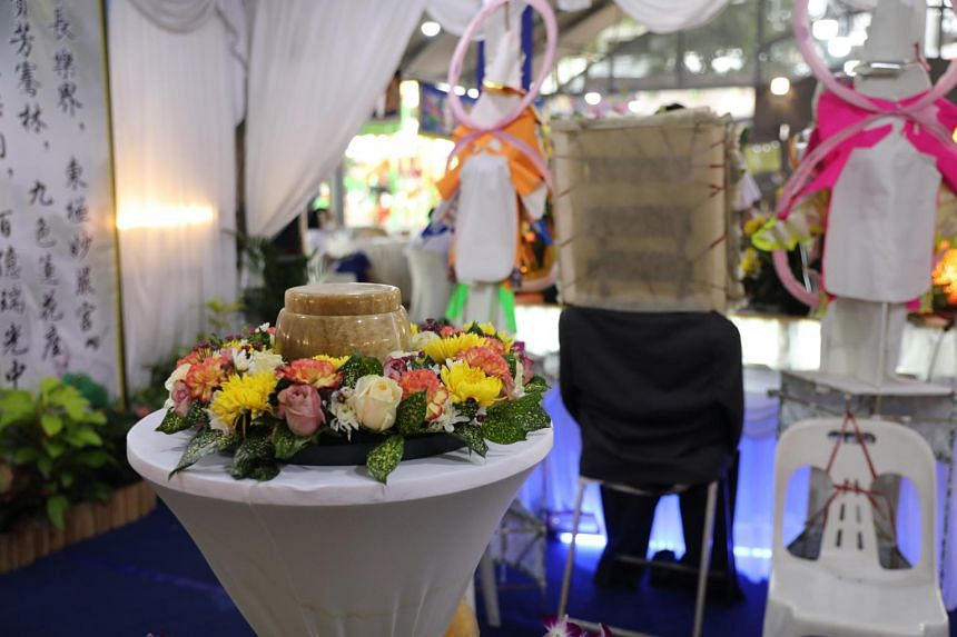 An urn sits on a small table instead of a coffin at the wake of the late Mr Kee Kin Tiong on Jan 3, 2020.