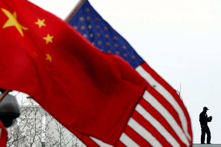 A lamp post is adorned with Chinese and US national flags in Washington on Jan 17, 2011.