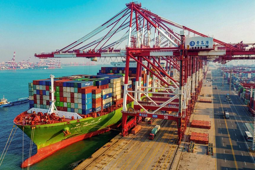 A cargo ship loaded with containers berths at a port in Qingdao in China's eastern Shandong province.