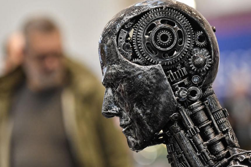 In a photo taken on Nov 29, 2019, a metal head made of motor parts symbolises artificial intelligence at the Essen Motor Show for tuning and motor sports, in Germany.