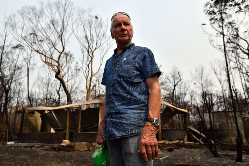 Environmentalist Ken Stewart seen in front of his burnt house recalling his escape from the bush fire in New South Wales, Australia, on Jan 15, 2020.