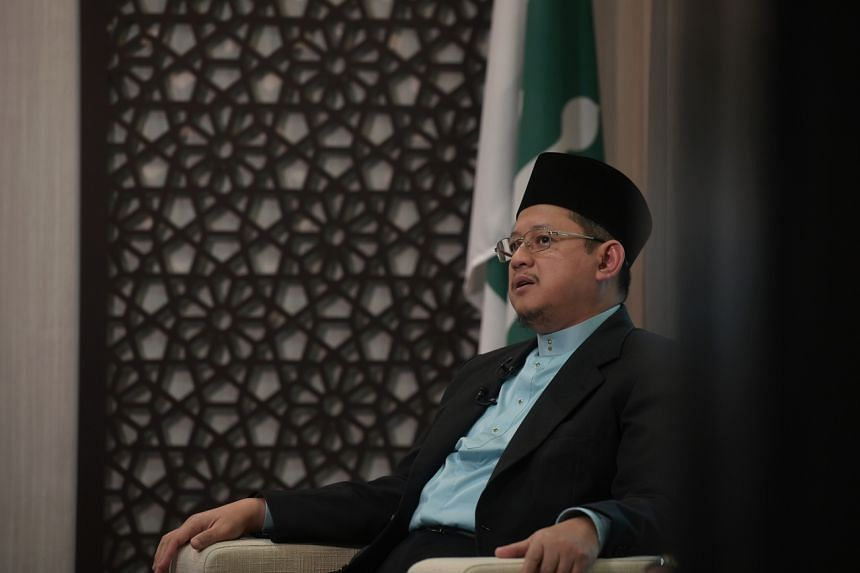 Ustaz Dr Mohamed Fatris Bakaram speaks to reporters at Muis on Jan 16, 2020.