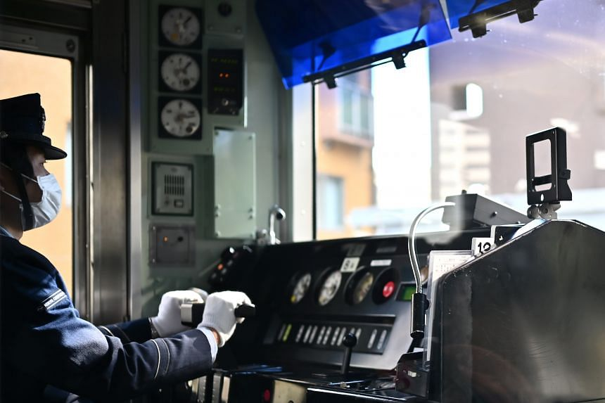 An operator drives a train of the Keikyu line to Haneda airport in Tokyo on Jan 14, 2020. The jump in November 2019 orders was largely driven by big-ticket items, such as orders for railway cars.