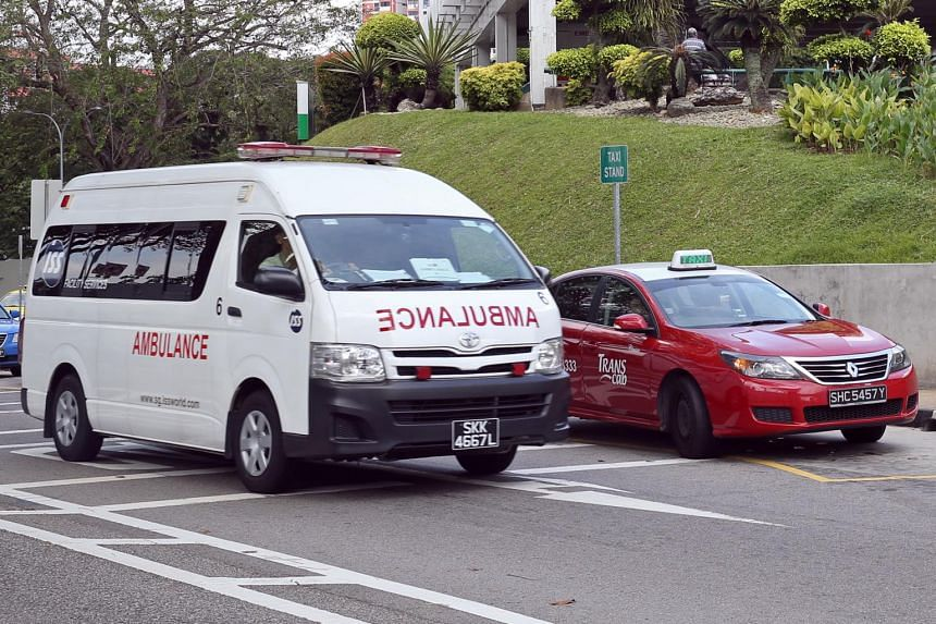 A photo of an ambulance and TransCab taxi in Singapore on Feb 20, 2017. More than half of all private ambulances in Singapore have met the new standards.