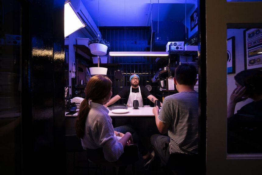 Chef Bjorn Shen presiding over the four-seat micro restaurant, Small's.