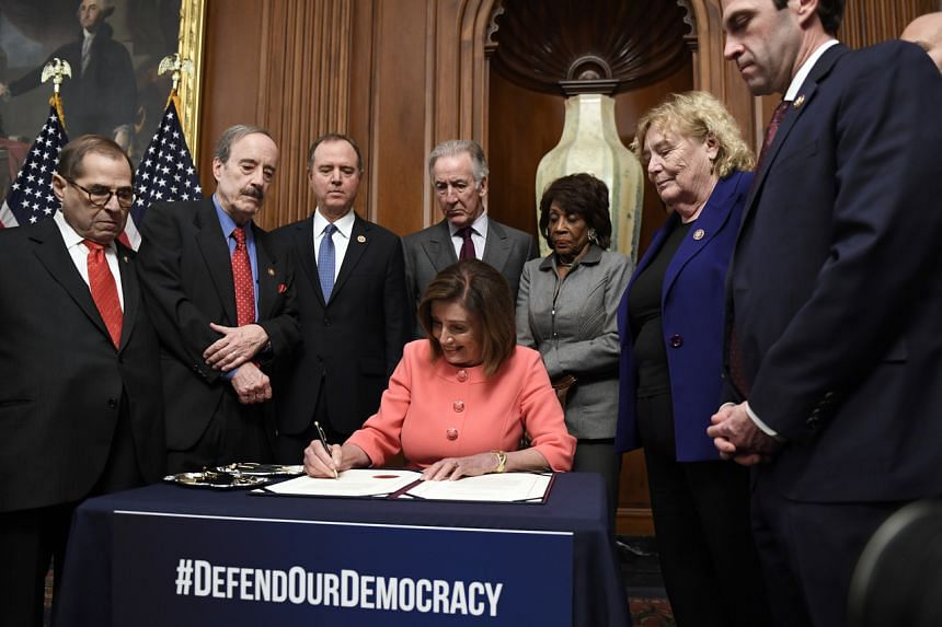 House Speaker Nancy Pelosi signs the resolution to transmit the two articles of impeachment against President Donald Trump to the Senate for trial, on Jan 15, 2020.