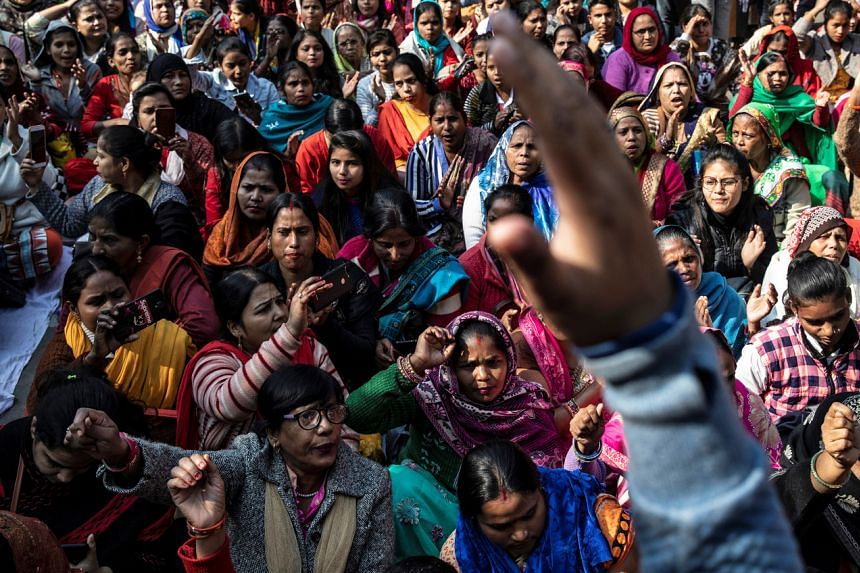 In a photo take on Dec 3, 2019, demonstrators shout slogans as they take part in a protest against the alleged rape and murder of a 27-year-old woman on the outskirts of Hyderabad.