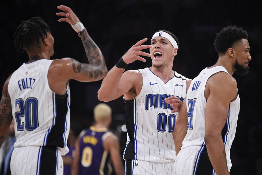 Orlando Magic forward Aaron Gordon (left) celebrates with guard Markelle Fultz (centre) during the second half against the Los Angeles Lakers at Staples Center on Jan 16, 2020.