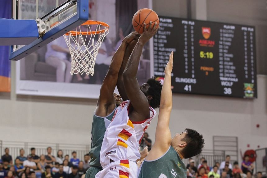Singapore Slingers' Anthony McClain (centre) in action against Macau Wolf Warriors during the Asean Basketball League match, on Dec 22, 2019.