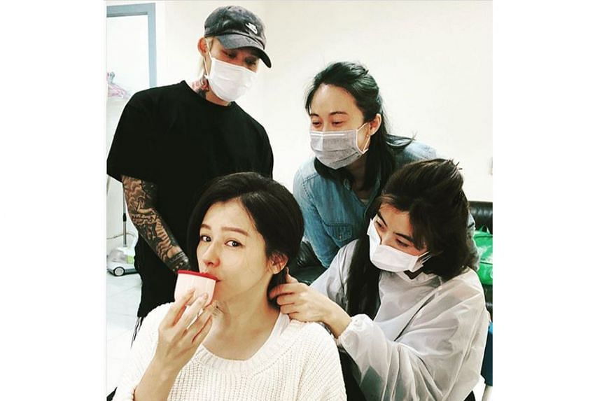 LET'S STOP THE GERMS: It is usually the people who are unwell wearing face masks in public. But Taiwanese singer Vivian Hsu, 44, who is suffering from a bad bout of flu, was unable to do so when she was getting her make-up done while preparing to rec