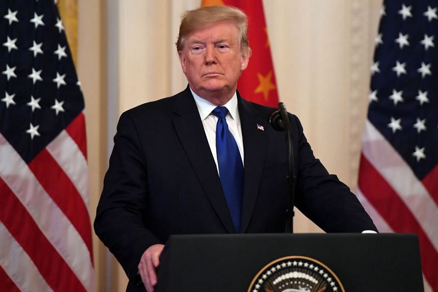 US President Donald Trump speaks before signing a trade agreement between the US and China.