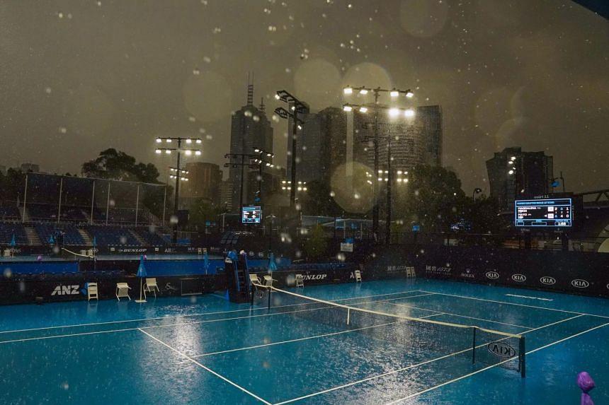 Heavy rain falls during an Australian Open practice session at Melbourne Park in Melbourne, Australia, on Jan 15, 2020.