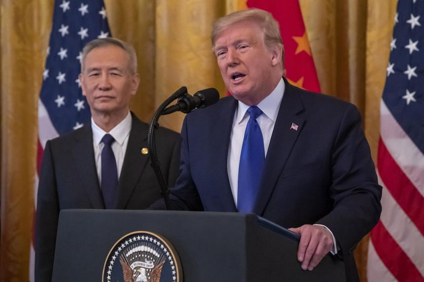 President Donald Trump (right) and Chinese Vice Premier Liu He participate in a signing ceremony of a China trade agreement, on Jan 15, 2020.