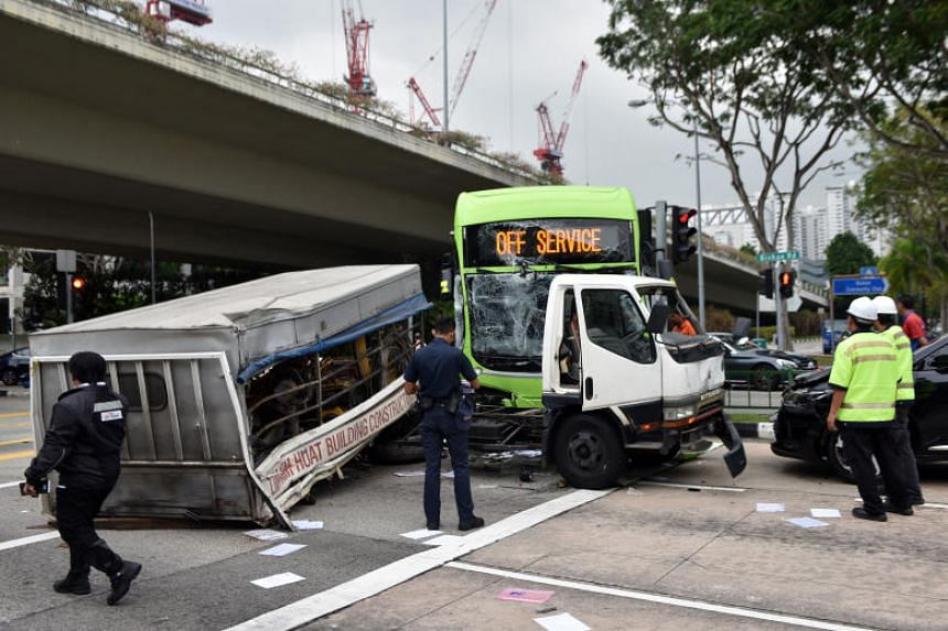 Eyewitnesses said that the collision between the lorry and the bus at the junction pushed the lorry to the opposite side of the road, causing it to hit the stationary car that was waiting for the traffic light to turn green.