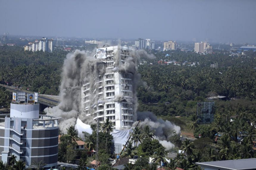 High-rise luxury apartment apartment Holy Faith H2O is brought to the ground by controlled implosion in Kochi, India, on Jan 11, 2020.
