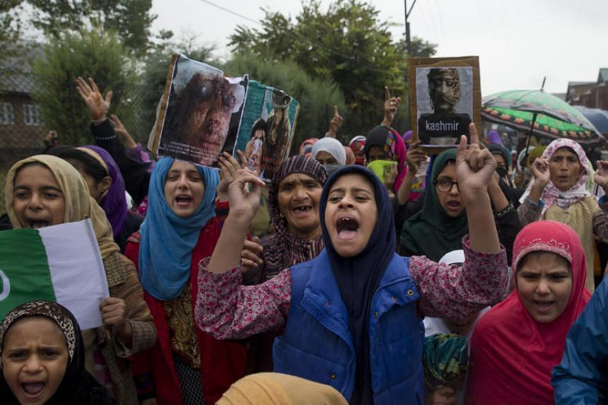 In a photo taken on Oct 4, 2019, people shout slogans against India revoking Muslim-majority Kashmir's semi-autonomous status during a protest on the outskirts of Srinagar, Indian-controlled Kashmir.