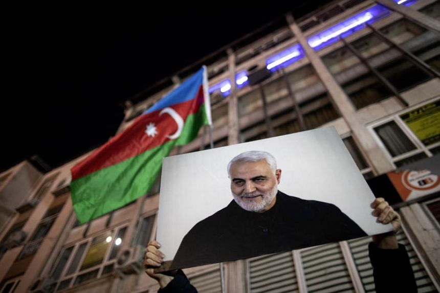 In a photo taken on Jan 10, 2020, people attend a commemoration for the slain Iranian commander Qassem Soleimani as they shout slogans against the USA and Israel in front of the Iranian Consulate in Istanbul.