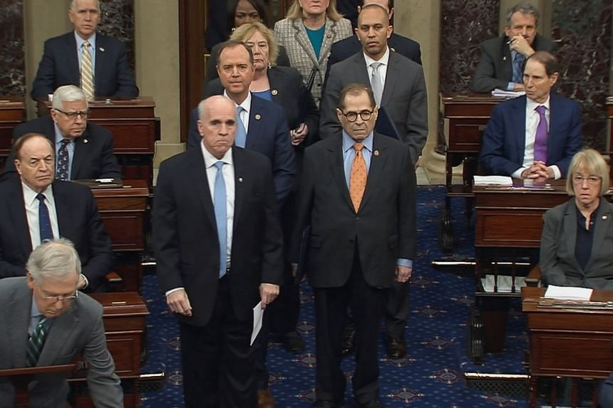 The US Senate Sergeant at Arms Michael Stenger escorts the US House impeachment managers at the US Capitol in Washington.