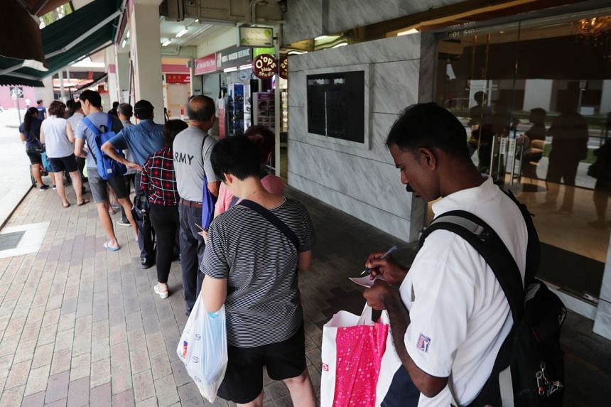 Punters queuing for the Reunion Draw at Block 513 Bishan Street 13.