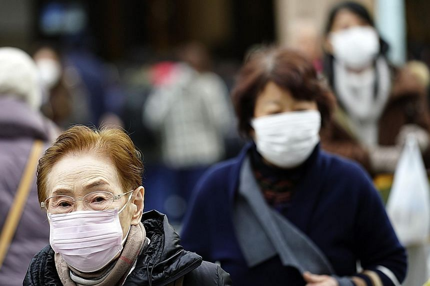 The Wuhan virus outbreak coincides with the annual flu season in Japan, and the country's Health Ministry has reiterated its advisory for people to wash their hands, gargle, and wear masks to avoid falling sick. PHOTO: ASSOCIATED PRESS