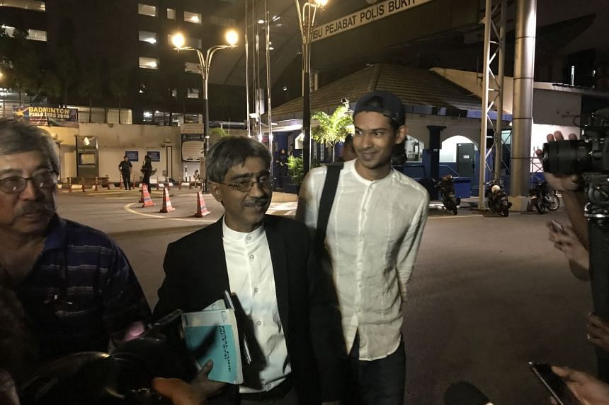 Mr Muhammed Yusoff Rawther (right) and his lawyer speaking to reporters on Dec 9, 2019,  after spending more than seven hours giving a statement to the Malaysian police.