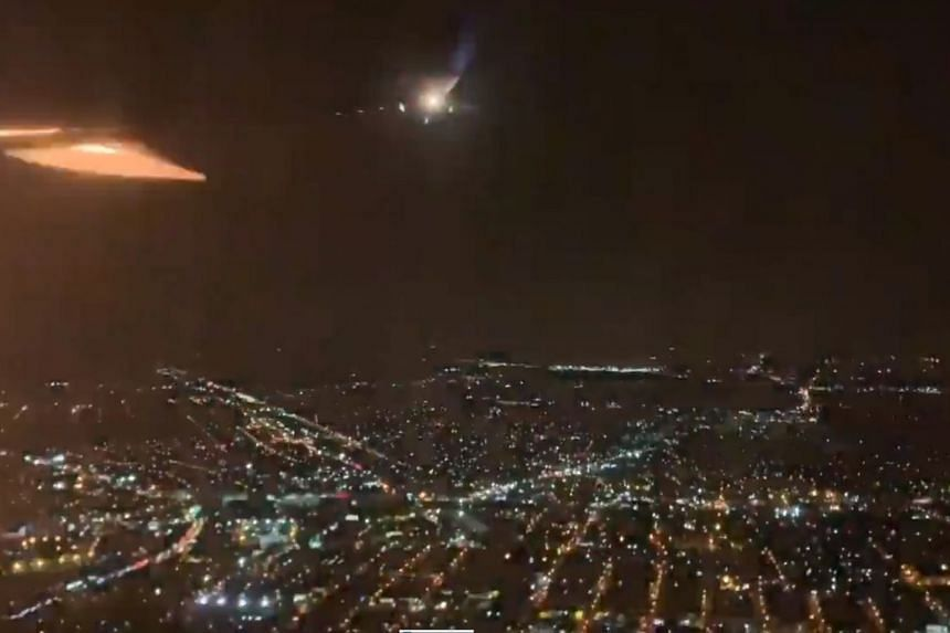 A screenshot from a video taken of the incident shows flames appearing by the plane's wing.