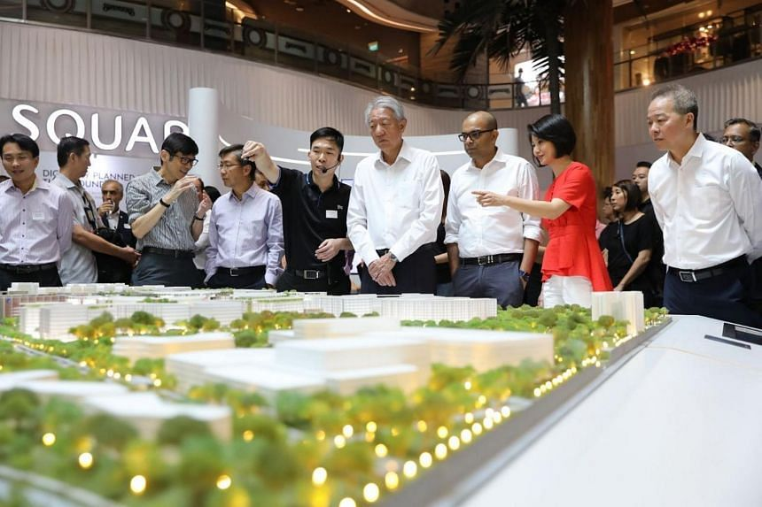 Senior Minister Teo Chee Hean (fourth from right), with Senior Minister of State for Transport Janil Puthucheary and Senior Parliamentary Secretary for Home Affairs and National Development Sun Xueling, looking at a scale model of Punggol Digital Dis