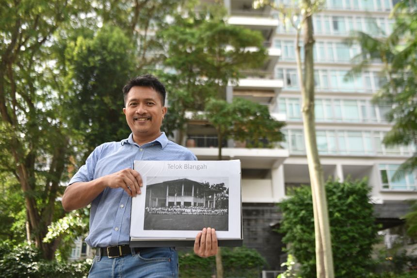 Heritage researcher Sarafian Salleh holding an undated picture of Istana Engku Khalid when Radin Mas Primary School was operating out of it.