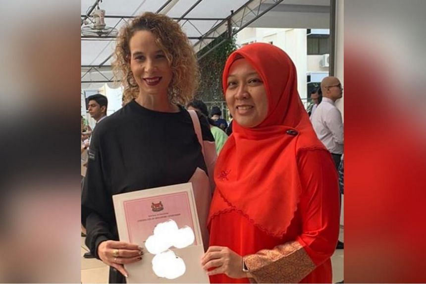 South Africa-born model Wendy Jacobs (left) with Dr Intan Azura Mokhtar (Ang Mo Kio GRC) at the Ang Mo Kio GRC and Sengkang West SMC Citizenship Ceremony.